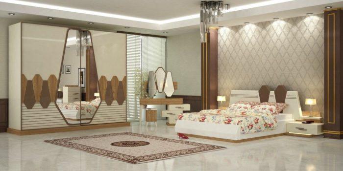غرفة نوم فى منتهى الجمال تحتوي على دولاب جرار وتسريحة بتصميم جديد كما ان اضاءة الاسبوتات تعطى منظر جميل