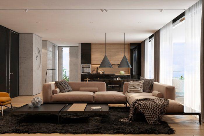 غرفة معيشة مودرن تتكو من ركنة كبيرة باللون البيج والسجادة السوداء تعطي فخامة وشياكة للغرفة