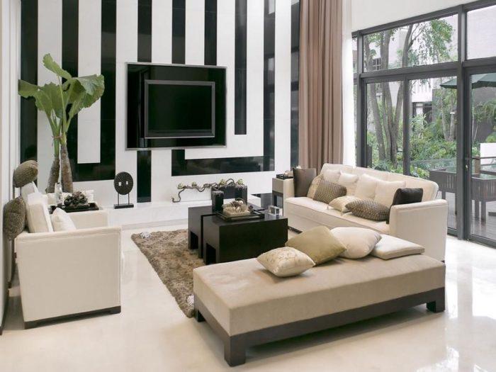 غرفة جلوس مودرن جميلة مكونة من كنبة ومقعدين وباف مستطيل مع ترابيزة خشبية سوداء