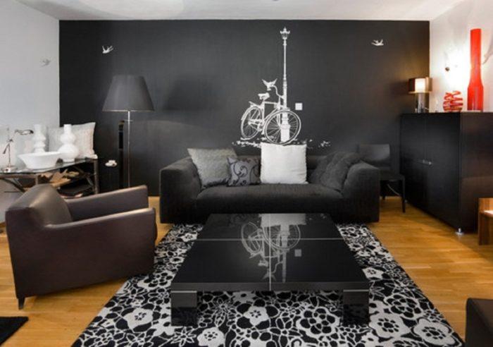 غرفة معيشة بتصميم رائع مكونة من كنبة وكرسي وترابيزة بتصميم روعة