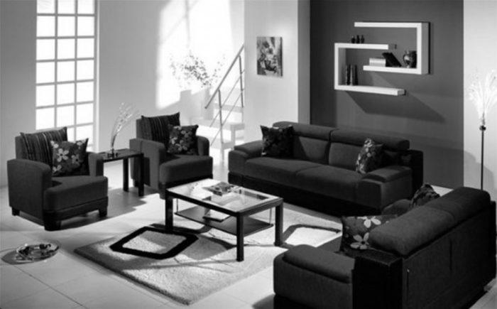 غرفة معيشة بسيطة جداً مكونة من 2 كنبة و2 كرسي بتصميم رائع وترابيزة روعة