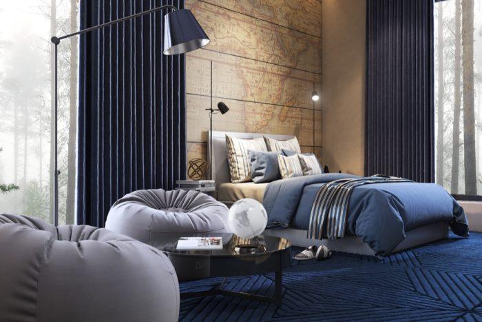 غرفة نوم بتصميم عصري جداً مكونة من سرير رمادي مع 2أباجورة عمود صغيرة والجانب لاخر من الغرفة يحتوي على 2 كراسي وترابيزة زجاجية سوداء