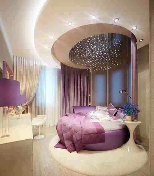غرفة نوم جميلة جداً مكونة من سرير دائري بتصميم رائع