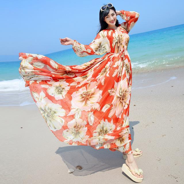 فستان شيفون طويل بأكمام باللون الحمر ومطبوع عيه ورود كبيرة باللون البيج
