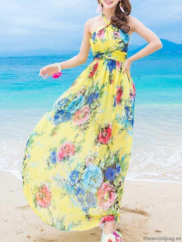فستان شيفون طويل بدون أكمام باللون الاصفر منقوش بورود متنوعة