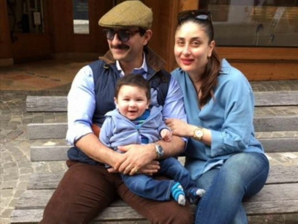 صورة للنجم سيف علي خان وزوجته كارينا كابور وابنهم تيمور