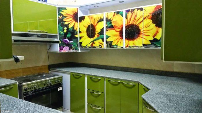 مطبخ الوميتال باللون الاخضر التفاحي مطبوع عليه رسمة عباد الشمس