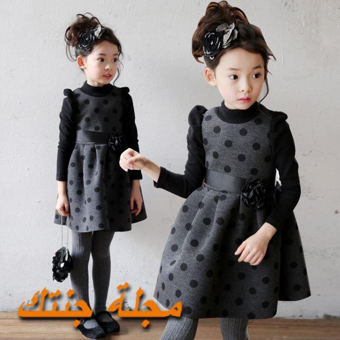 فستان باللون الرمادي والاسود