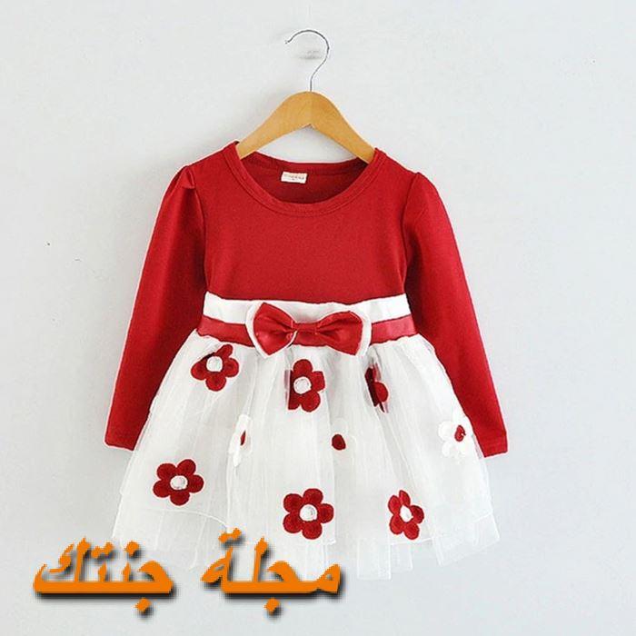 فستان شتوي سن سنة باللون الابيض والاحمر